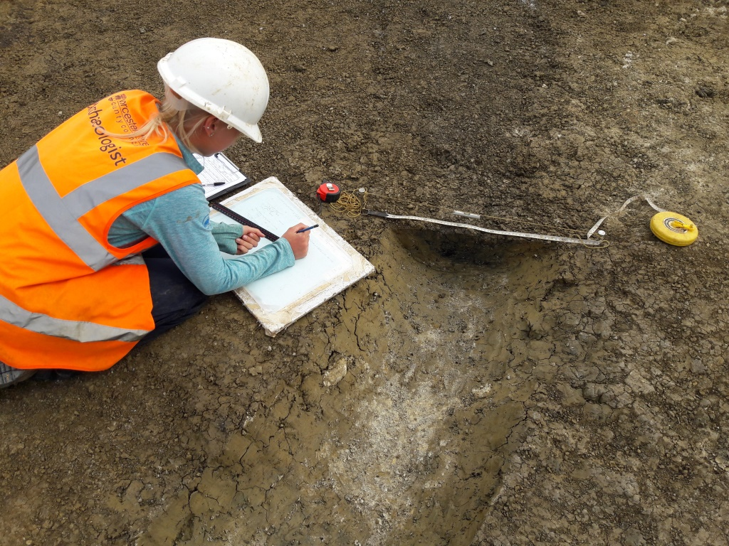 Archaeologist recording roundhouse gully