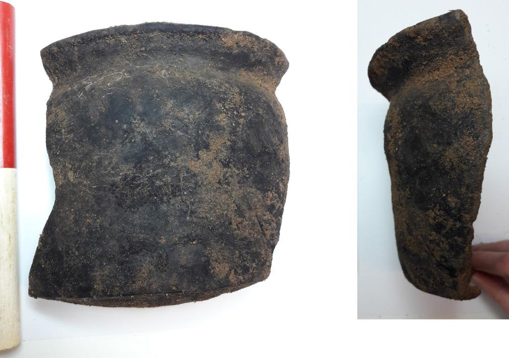 Black pot with flared rim and straight sides