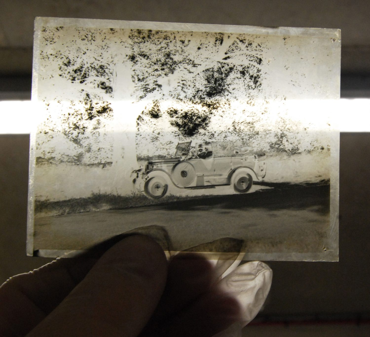 Glass photographic negative of a car