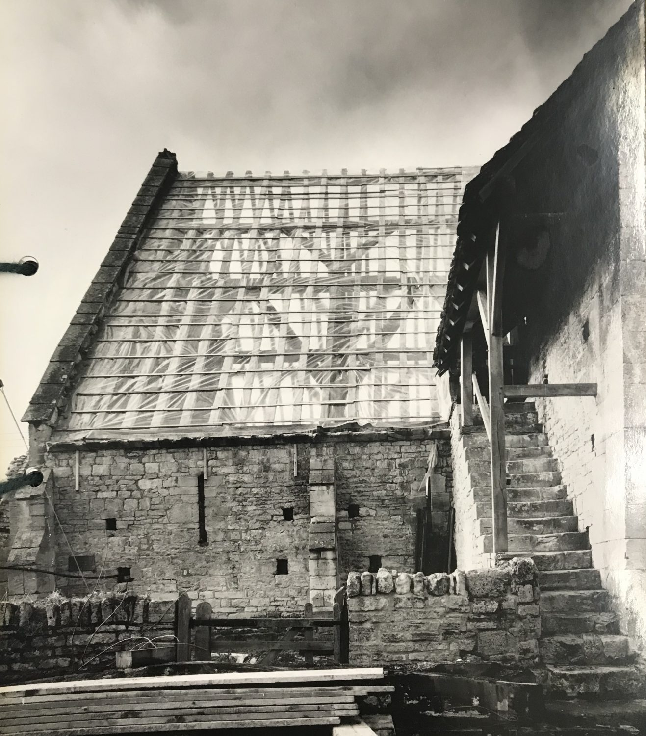 View of Bredon Barn roof from the outside, temporarily covered while undergoing reconstruction