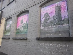 Three Whinfield slides pasted into bricked up windows