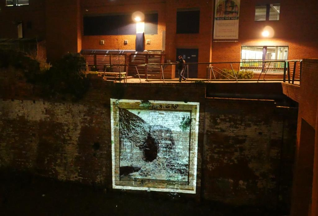 Square light projection onto historic city wall