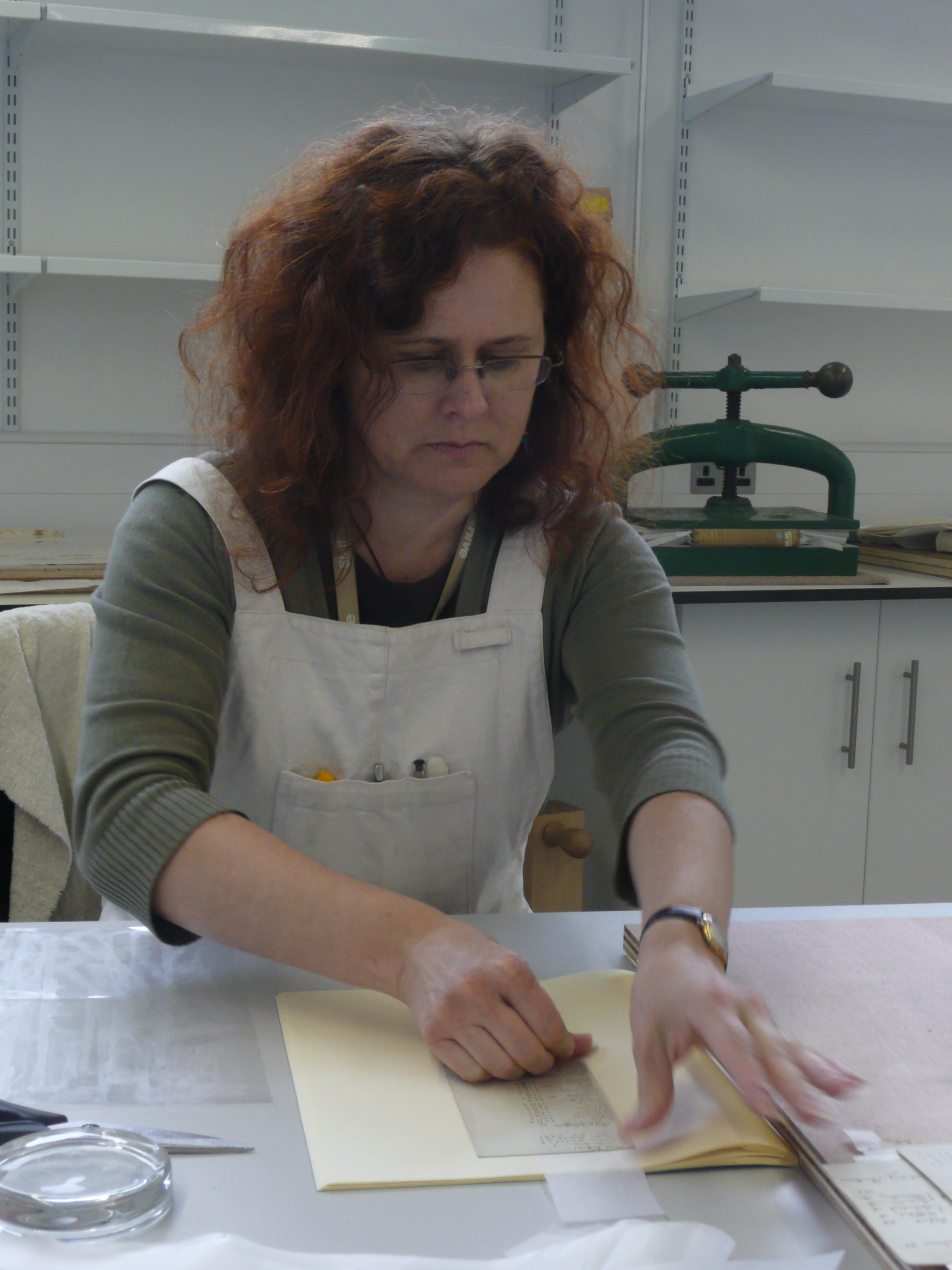 Rhonda, our Conservator, working on documents