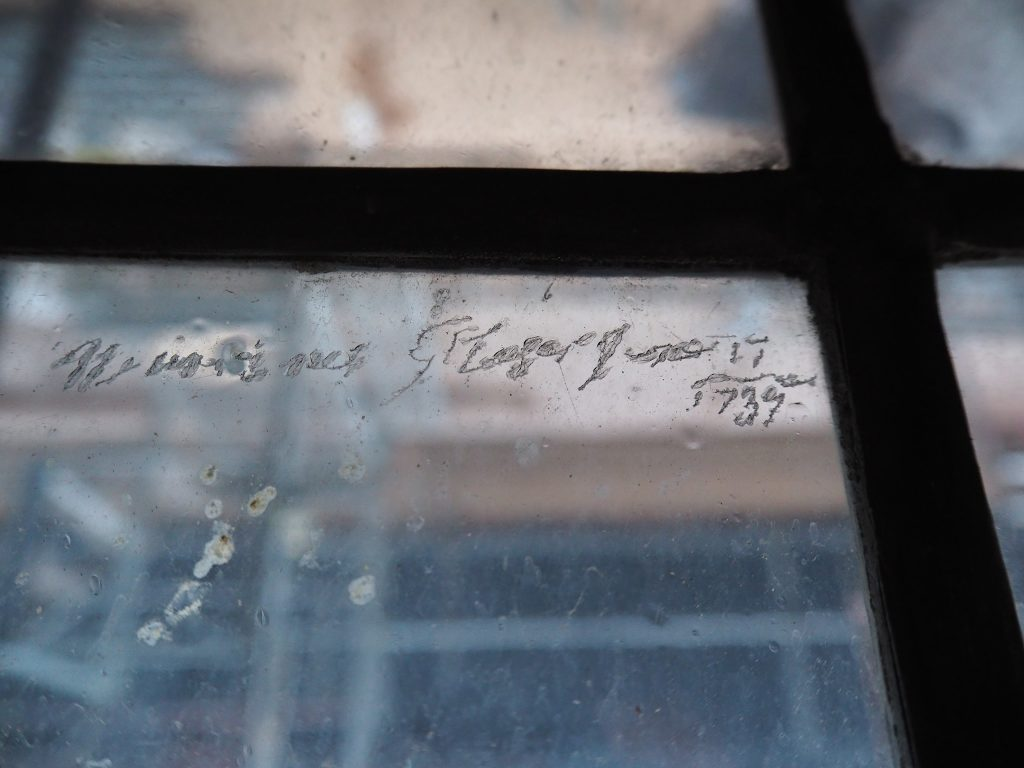Graffiti etched into a window