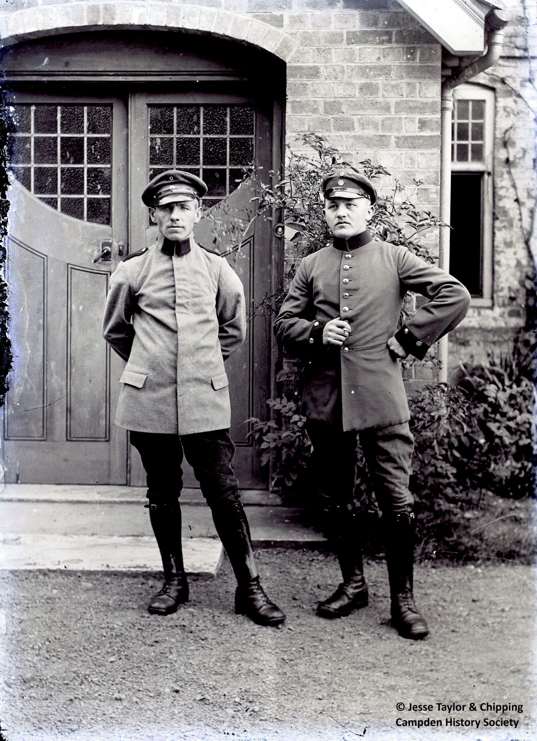 Portrait of two uniformed POWs