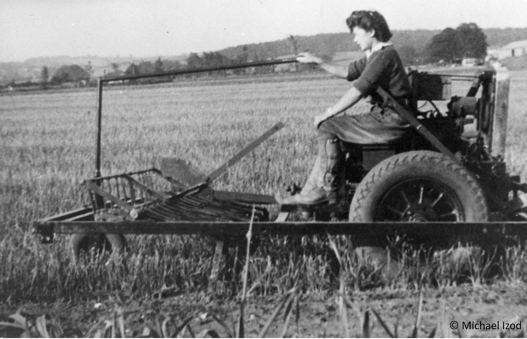 Land girls driving a hoeing machine