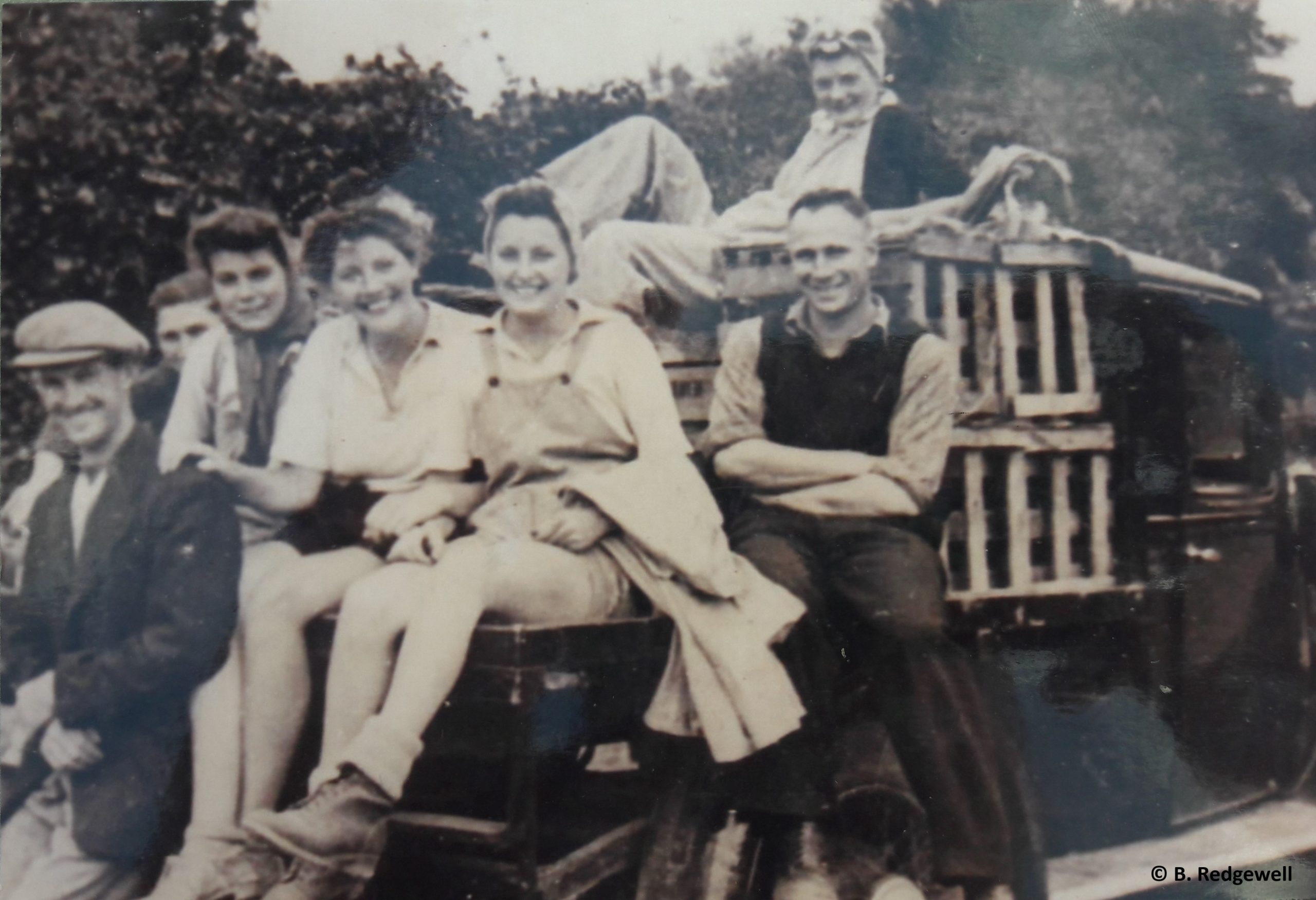 Land girls and employers by truck