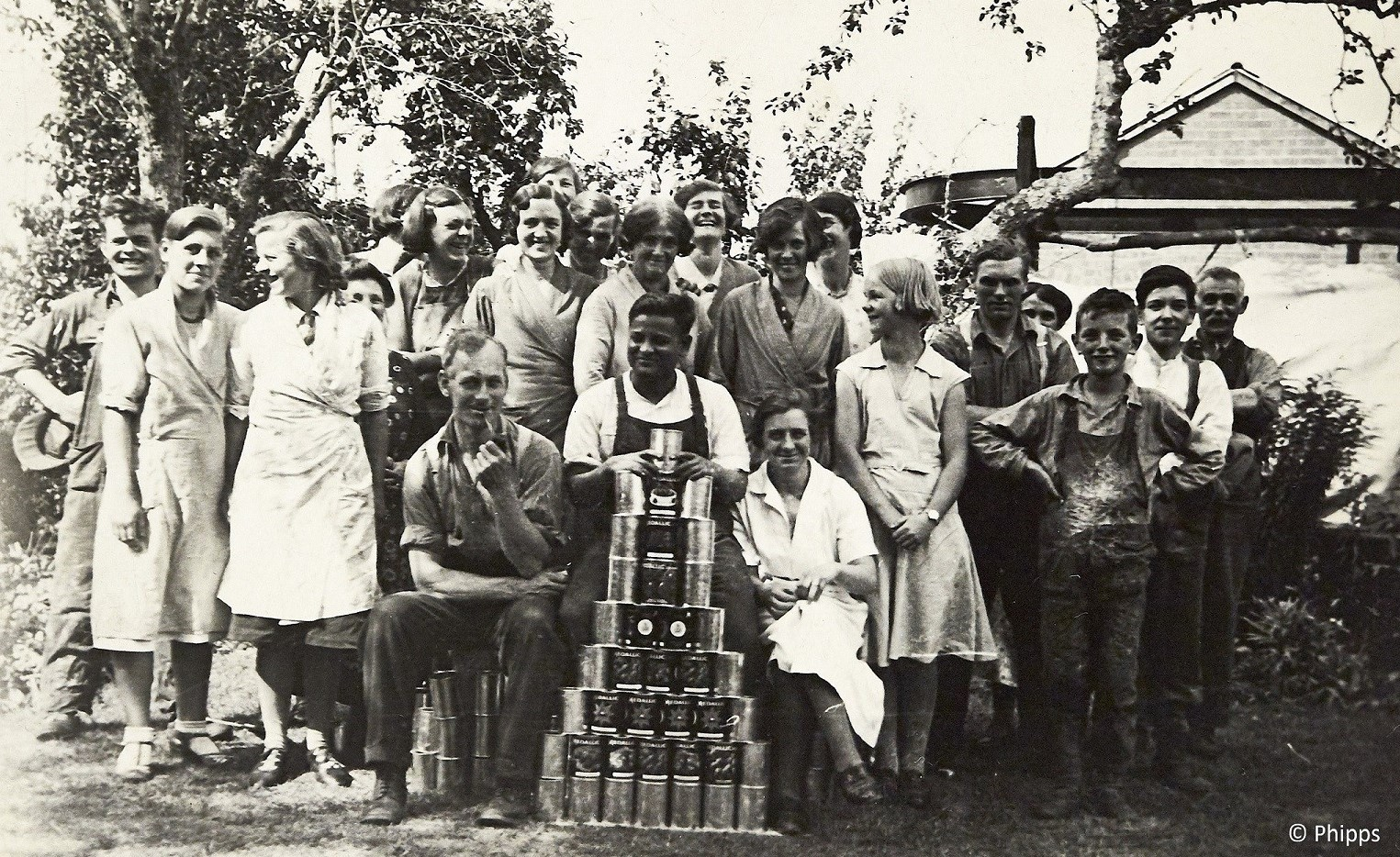 Group of workers with display of canned goods - informal, relaxed shot