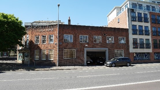 This purpose-built funeral parlour, in Worcester, was completed in 1938, to a design by Henry Rowe. Still in use as funeral directors today the building makes a strong contribution to the street scene.