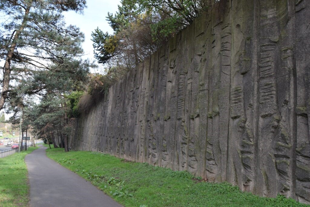 This retaining wall with decorative sculptural relief by William Mitchell, in Kidderminster, was listed in 2020 for its architectural and historic interest.
