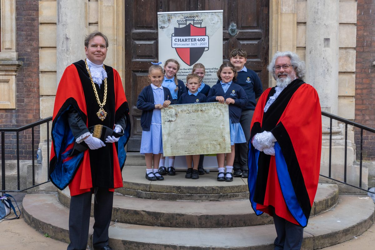 Mayor and Deputy Mayor with a replica of the 1621 Charter