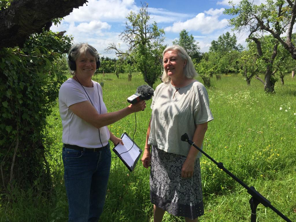 Julia letts and one of our volunteers recording link pieces for the podcast
